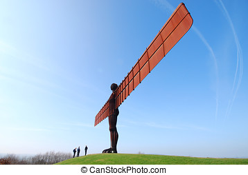 Angel of the North attraction - Tourists stand below the...