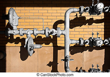 Gas Supply - Deeply shadowed regulators and gagues of a...