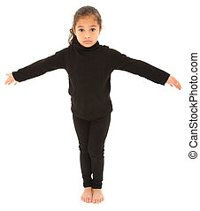 Serious Hispanic Preschooler Standing arms outstretched on White Floor. Clipping path.