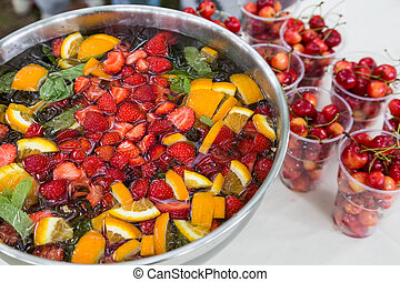 mixed punch with fruits in metal bowl