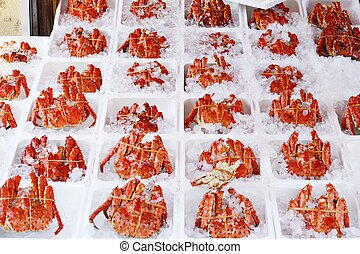 Crabs at a Market - Crabs packed in ice on sale at a morning...