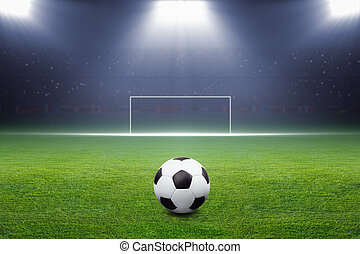 Soccer ball, goal, spotlight - Soccer ball on green stadium,...