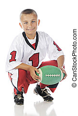 Have Football, Will Play - A handsome elementary boy holding...
