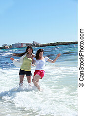 Two women frolicking in the sea