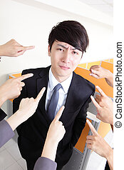 All hands finger pointing at a businessman