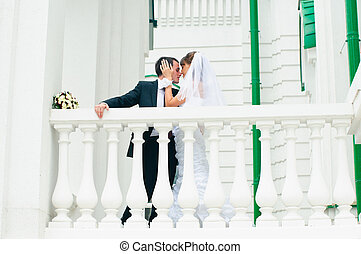 groom embracing bride and tender touching. Love couple