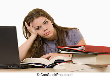 Frustrated college student - Young woman sitting in front of...