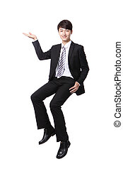 business man sitting on some thing and show copy space by...