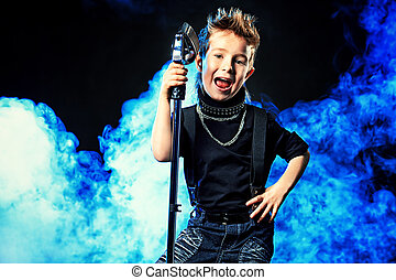 cool boy singing - Emotional little boy is singing into a...