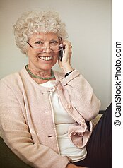 Cheerful Old Woman on Phone