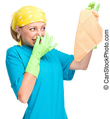 Young woman as a cleaning maid holding rag and pinching her...