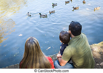 Mixed Race Mother and Father with Son at the Pond