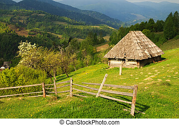 Spring morning landscape with the picturesque little farm in...