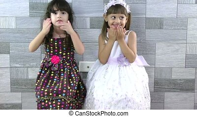 little girls sending kisses