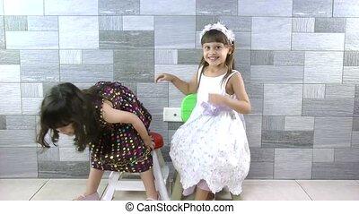 Sweet little girls inside house for