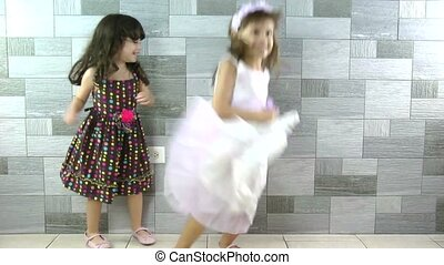 Happy little girls dancing