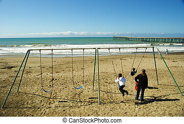 Swingset on the Beach - This family enjoys the swingset on...