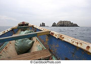 African pirogue canoe sailing off Dakar