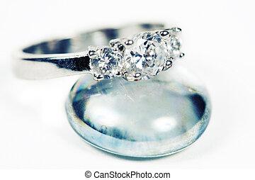 Engagement Ring taken closeup on glass pebble