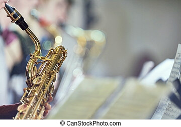 Saxophone in band with score