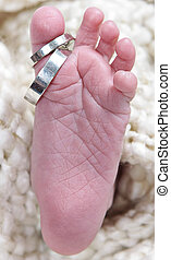 Babies foot taken closeup with rings - babies foot taken...