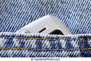 Cellular phone in the jeans pocket