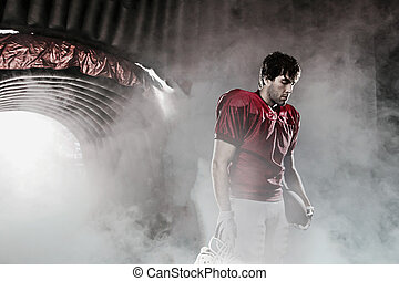 Football player with a red uniform, in a stadium with fans...