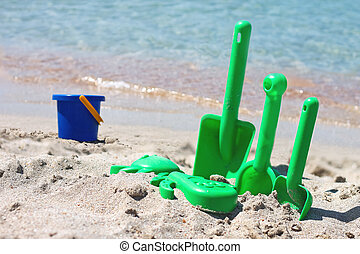 Children sand toys on the beach near the sea