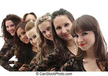 Group of young smiling girls posing in studio