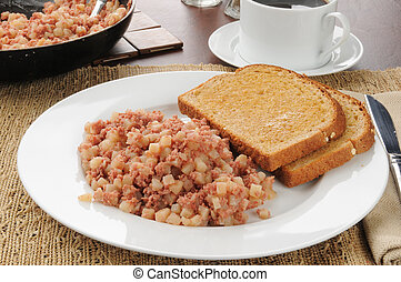 Corned beef hasn and toast - A plate of corned beef hash...