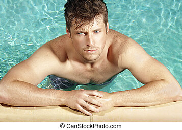 Pool boy - Summer portrait of a handsome young cool guy in...