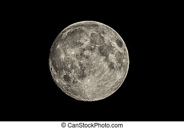 Full moon - Closeup shot of a full moon on a black...