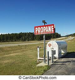 Propane tank on side of road. - Propane tank.