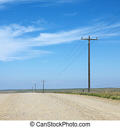 Power lines on rural road.