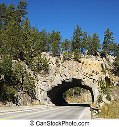 Road tunnel through rock. - Tunnel going through rocks in...