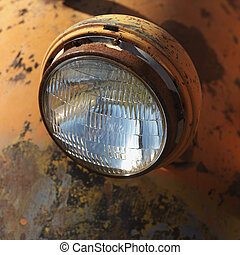 Headlight of old truck. - Close-up of headlight of scratched...
