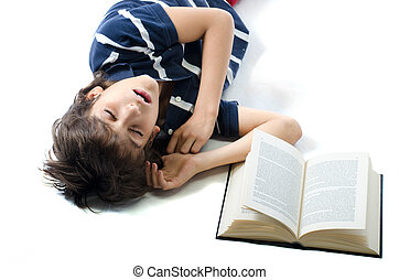 Young student sleeping with open book next to him - Young...