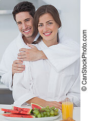 Man embracing his wife in the kitchen