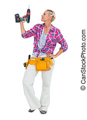 Handy woman standing with power drill