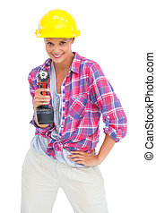 Smiling handy woman with a power drill on white background