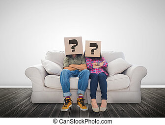 Funny couple wearing boxes with question mark on their head...