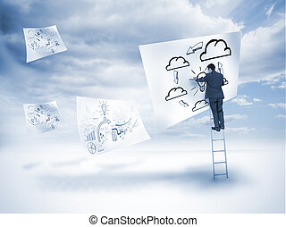Businessman drawing on a floating paper with blue sky on the...