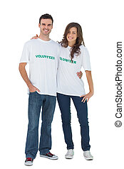 Two young people wearing volunteer tshirt on white...