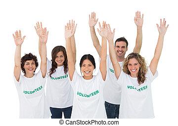 Grupo, voluntários, levantamento, braços