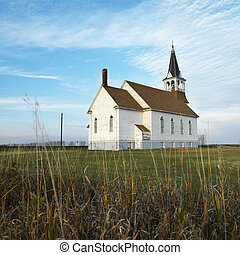 Rural church in field. - Small rural church in field with...