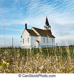 Rural church in field - Small rural church in field with...