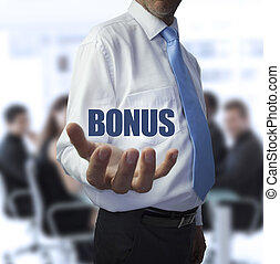 Smart businessman holding the word bonus in front of a...