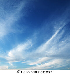 Cirrus clouds in sky. - Cirrus cloud formation in blue sky.