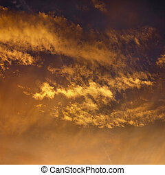 Clouds in sunset sky.