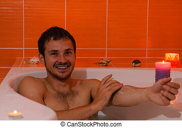 Man relaxing bathing. - Beautiful young Bath man relaxing...